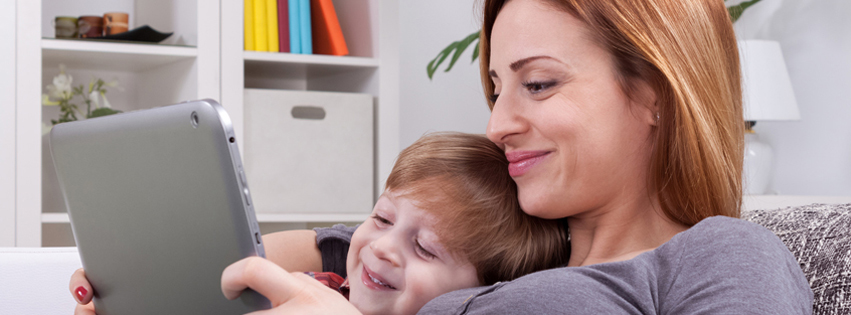 Smiling mother and son using tablet